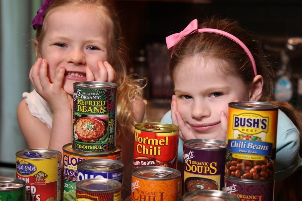 Rebecca's kids in the kitchen with cans
