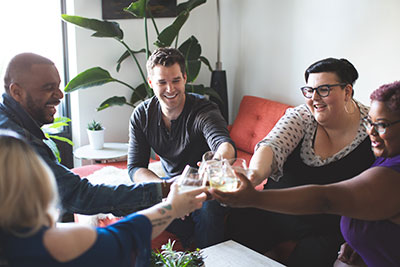 Group of friends toasting glasses